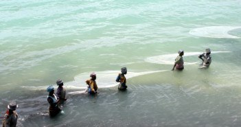 African women fishing in the shallow water