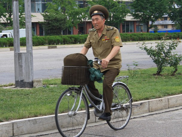 A soldier in North Korea rides to work